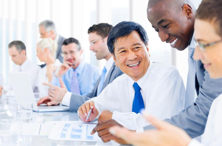 Laughing men in a meeting