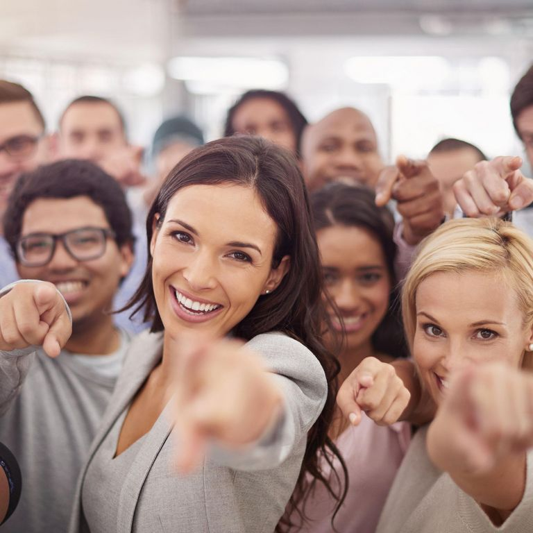 Group of employees pointing at you